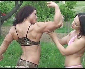 Thin girl touches and feels Oana Hrepca's big, rock hard biceps.