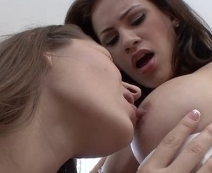 Adorable lesbians are playing with each other's pussies and clits