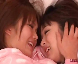 2 Asian Girls In Pijamas Kissing Rubbing Tits On The Bed In The Room