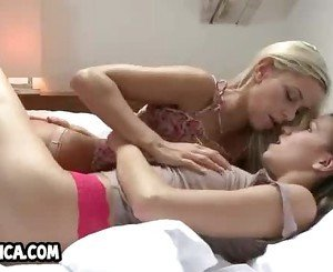Two hot amateur lesbian babes kissing each other