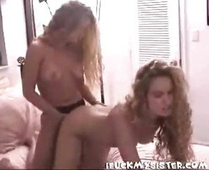 twin lesbians having strap-on fun